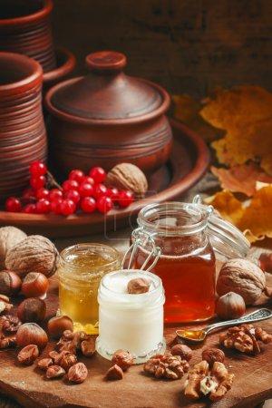 Three types of honey with walnuts and hazelnuts
