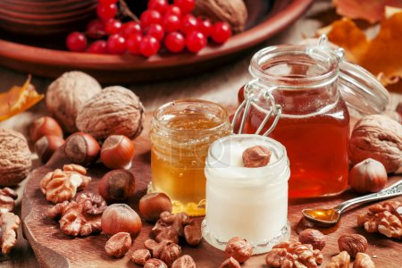 Three types of honey with walnuts and hazelnuts