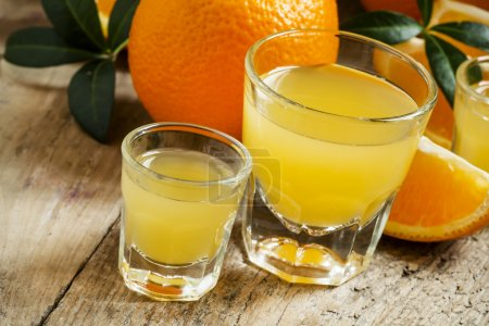 Fresh orange juice in a large and a small glasses