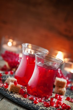 Festive red hot drink with pomegranate