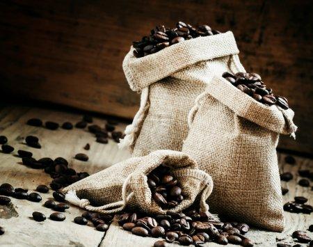 Grains of roasted coffee in bags