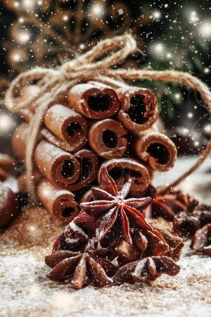Christmas decoration with cinnamon, anice, pine cones and spruce branches