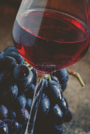 Red wine and dark grapes