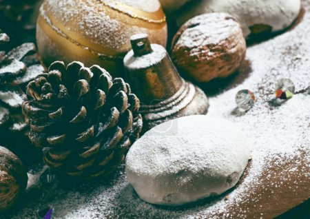 Gingerbread, fir cones, nuts, bell and ball
