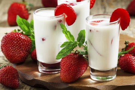 Strawberry milk in glass jars