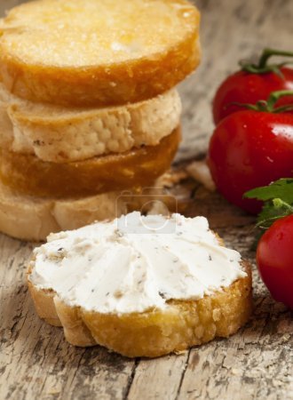 Photo for Home crostini with soft cheese and tomatoes on a wooden table, selective focus - Royalty Free Image