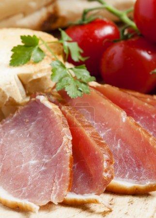 Pork smoked ham and tomatoes