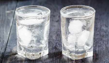 Cold fresh water with ice in a glasses