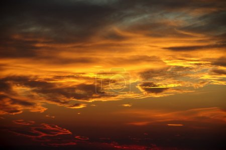 View of beautiful orange sky with clouds at sunset...