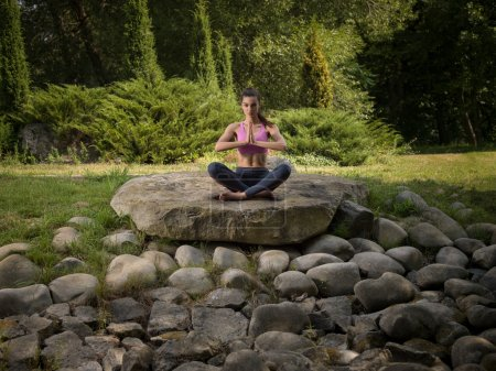 Girl meditates in the lotus position.