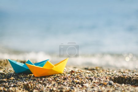 paper boats on beach