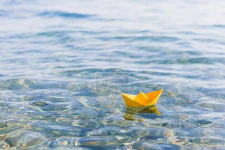 paper boat sailing on water