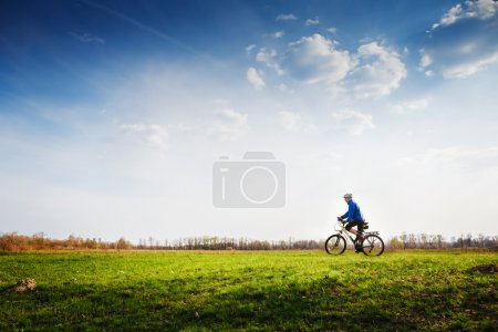 Young cyclist riding a bicycle