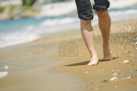 female feet on beach