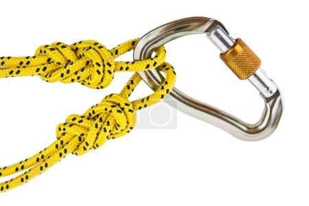 Photo pour Mousqueton pour alpinistes en métal avec corde jaune - image libre de droit