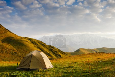 Tourist tent in camp on  meadow