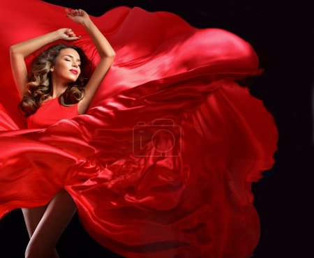 Young woman in red flying dress