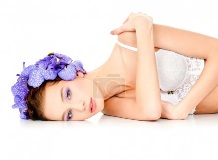 model with orchid flowers in hair.