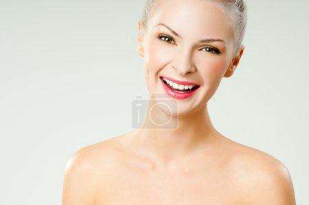 young beautiful girl laughs