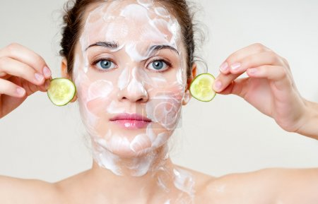 woman cares for face skin