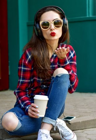Beautiful smiling woman with headphones