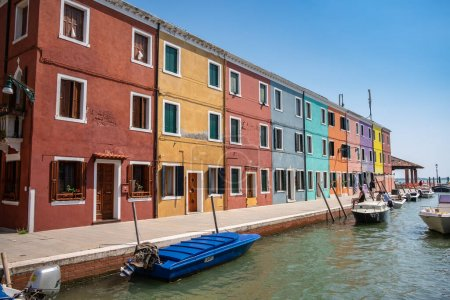 Photo for Venice landmark, Burano island canal, colorful houses and boats - Royalty Free Image