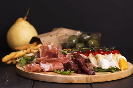 Various types of italian appetizers: ham, cheese, ...