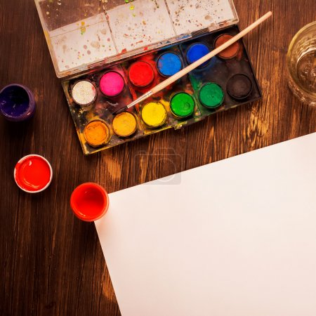 Photo for Back to school: paints, brushes, paper. Artist tools. Art concept - Royalty Free Image