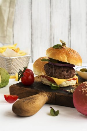 Homemade burger and ingredients
