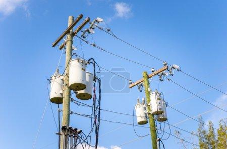 Electricity Poles against Blue Sky