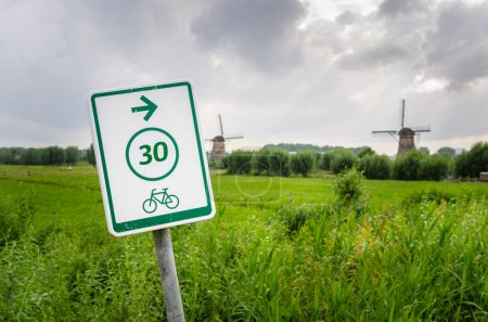 Withe Sign on a Bicycle Path through the Countryside and Cloudy sky