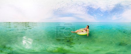 Girl in inflatable ring floating