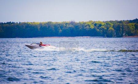 Speed motor boat on azure lake