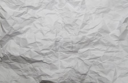 crumpled , textured sheet of white paper