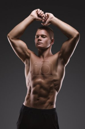 Healthy muscular young man posing.  Sport portrait.