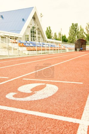 Stadium. Treadmill with number six. Sport and fitness.