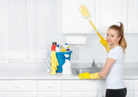 Photo for Cleaning service, woman do clean kitchen with detergen - Royalty Free Image