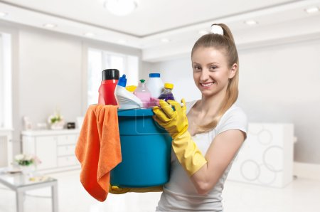 Photo for Cleaning service, woman do clean kitchen with cleaning supplie - Royalty Free Image