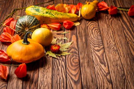 Autumn background on wooden boards. Selective focus. Space for text.