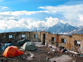 Tent camp in the destroyed walls of the hotel