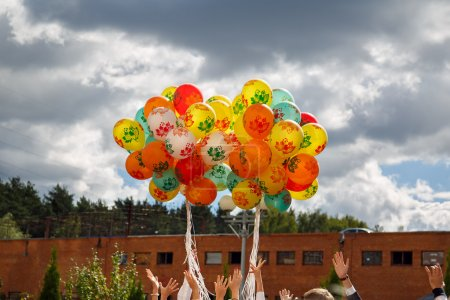 Bunch of balloons rising into the sky at the celebration of the beginning of the new school year.