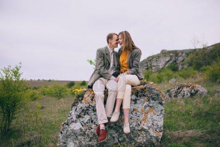 loving couple sitting on the stone