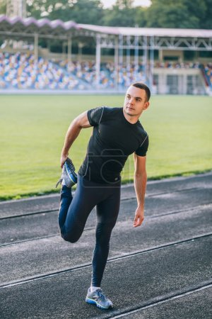 Photo for Man stretches the body before running - Royalty Free Image