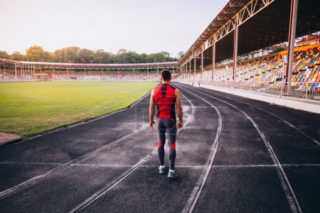 Photo for Back view of male athlete in stadium. Sprinter - Royalty Free Image