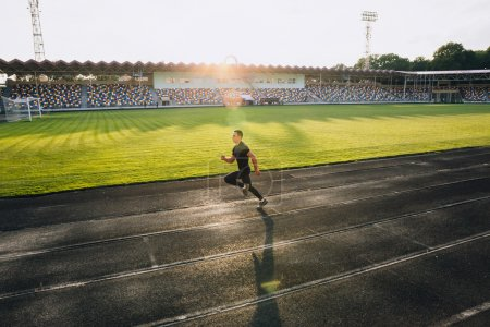 Runner on sport stadium