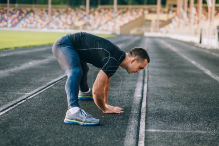 man stretches before running