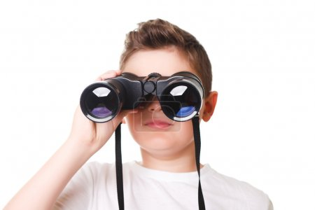 Little boy is looking through binoculars. Isolated over white