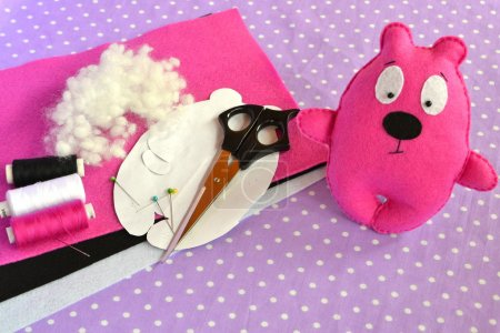 Pink felt Teddy bear, handmade toy. Scissors, needle, thread, pins, paper templates - sewing kit