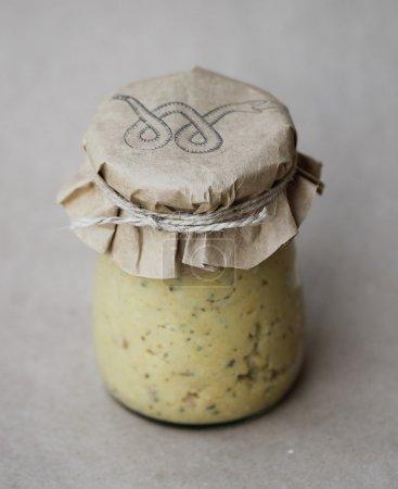 Homemade hummus in jar