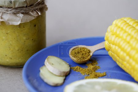 Corn sauce in jar with ingredients